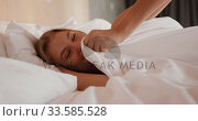 Купить «Caucasian woman resting in bed in hotel room», видеоролик № 33585528, снято 13 мая 2019 г. (c) Wavebreak Media / Фотобанк Лори