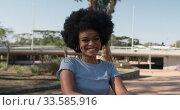 Купить «Front view of mixed race woman in park», видеоролик № 33585916, снято 17 мая 2019 г. (c) Wavebreak Media / Фотобанк Лори