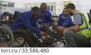 Купить «Workers with disabled man working», видеоролик № 33586480, снято 28 сентября 2019 г. (c) Wavebreak Media / Фотобанк Лори