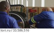 Workers making a wheelchair. Стоковое видео, агентство Wavebreak Media / Фотобанк Лори