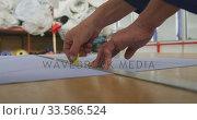 Купить «Worker measuring at the rule», видеоролик № 33586524, снято 28 сентября 2019 г. (c) Wavebreak Media / Фотобанк Лори