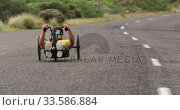 Купить «Disabled man riding a recumbent bicycle», видеоролик № 33586884, снято 16 апреля 2019 г. (c) Wavebreak Media / Фотобанк Лори