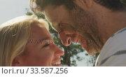 Купить «Young couple in love smiling», видеоролик № 33587256, снято 15 августа 2019 г. (c) Wavebreak Media / Фотобанк Лори
