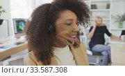 Купить «Woman talking at a customer with headphone», видеоролик № 33587308, снято 9 ноября 2019 г. (c) Wavebreak Media / Фотобанк Лори