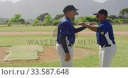 Baseball players stretching . Стоковое видео, агентство Wavebreak Media / Фотобанк Лори