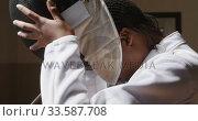 Купить «Female fencer athlete during a fencing training in a gym», видеоролик № 33587708, снято 16 ноября 2019 г. (c) Wavebreak Media / Фотобанк Лори
