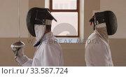 Купить «Fencer athletes during a fencing training in a gym», видеоролик № 33587724, снято 16 ноября 2019 г. (c) Wavebreak Media / Фотобанк Лори
