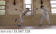 Купить «Fencer athletes during a fencing training in a gym», видеоролик № 33587728, снято 16 ноября 2019 г. (c) Wavebreak Media / Фотобанк Лори