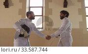 Купить «Fencer athletes during a fencing training in a gym», видеоролик № 33587744, снято 16 ноября 2019 г. (c) Wavebreak Media / Фотобанк Лори