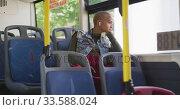 Купить «Mixed race woman taking the bus», видеоролик № 33588024, снято 10 января 2020 г. (c) Wavebreak Media / Фотобанк Лори