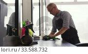 Купить «Distant view hairdresser cleaning the room», видеоролик № 33588732, снято 29 апреля 2019 г. (c) Wavebreak Media / Фотобанк Лори