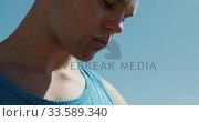 Купить «Close up view of male rower looking at his watch», видеоролик № 33589340, снято 27 ноября 2019 г. (c) Wavebreak Media / Фотобанк Лори