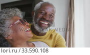 Купить «A senior african american couple spending time together at home in love social distancing in quarant», видеоролик № 33590108, снято 12 ноября 2019 г. (c) Wavebreak Media / Фотобанк Лори