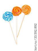Купить «Colourful lollipop isolated on the white background», фото № 33592892, снято 15 июля 2020 г. (c) age Fotostock / Фотобанк Лори