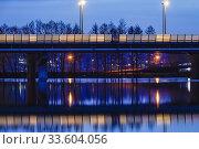 Купить «Stockholm, Sweden Night landscape over Lake Mälaren looking towards Varby and the E4 highway.», фото № 33604056, снято 6 апреля 2020 г. (c) age Fotostock / Фотобанк Лори