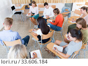 Купить «Students writing examination while sitting in semicircle», фото № 33606184, снято 26 сентября 2018 г. (c) Яков Филимонов / Фотобанк Лори