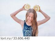 Купить «Adorable little girl have fun at tropical beach during vacation», фото № 33606440, снято 21 июня 2019 г. (c) Дмитрий Травников / Фотобанк Лори