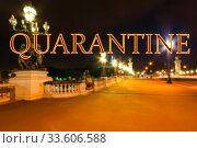 Coronavirus in Paris, France. Quarantine sign on a blurred background. Concept of COVID pandemic and travel in Europe. The Alexander III bridge at night. Стоковое фото, фотограф Владимир Журавлев / Фотобанк Лори