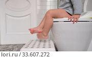 Купить «Crop toddler sitting on toilet», видеоролик № 33607272, снято 14 апреля 2020 г. (c) Ekaterina Demidova / Фотобанк Лори