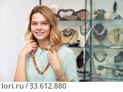 Woman trying on necklace from semiprecious stones. Стоковое фото, фотограф Яков Филимонов / Фотобанк Лори