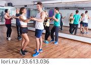 Men and women dancing salsa o bachata. Стоковое фото, фотограф Яков Филимонов / Фотобанк Лори