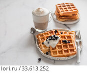 Breakfast belgian waffles, cappuccino. Copy space. Стоковое фото, фотограф Ольга Сергеева / Фотобанк Лори