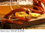 Купить «Crayfish with beer on a wooden table», фото № 33613916, снято 20 апреля 2020 г. (c) Марина Володько / Фотобанк Лори