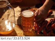 Купить «Crayfish with beer on a wooden table», фото № 33613924, снято 20 апреля 2020 г. (c) Марина Володько / Фотобанк Лори