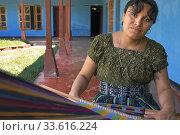 A mayan woman tz'utujile working in the textil in San Juan de la Laguna, Sololá, Guatelama. Редакционное фото, фотограф Sergi Reboredo / age Fotostock / Фотобанк Лори