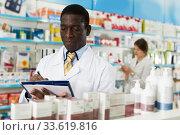 pharmacist taking inventory of medicines. Стоковое фото, фотограф Яков Филимонов / Фотобанк Лори
