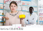 Купить «surprised by prices female holding remedy», фото № 33619832, снято 2 марта 2018 г. (c) Яков Филимонов / Фотобанк Лори