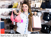 female customer showing her purchases in underwear shop. Стоковое фото, фотограф Яков Филимонов / Фотобанк Лори
