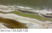 Купить «Aerial view, flying over the salty sands of the litoral zone on Kuyalnik Liman. Camera moves upwards above the coastline Kuyalnik Estuary, Odessa Oblast, Ukraine», видеоролик № 33620132, снято 6 апреля 2020 г. (c) Некрасов Андрей / Фотобанк Лори