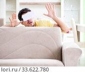 Купить «Young man with virtual reality goggles», фото № 33622780, снято 8 мая 2018 г. (c) Elnur / Фотобанк Лори