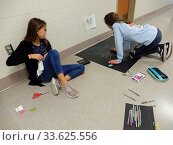 Купить «Middle School Girls Working on Art Projects, Wellsville, New York, USA.», фото № 33625556, снято 30 октября 2019 г. (c) age Fotostock / Фотобанк Лори