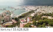 Купить «Panoramic view of Mediterranean coastal city of Malaga with harbor, Spain», видеоролик № 33628828, снято 18 апреля 2019 г. (c) Яков Филимонов / Фотобанк Лори