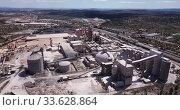 Купить «View from drone of cement plant industrial area, Bunol, Spain», видеоролик № 33628864, снято 24 апреля 2019 г. (c) Яков Филимонов / Фотобанк Лори