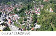 Купить «Picturesque aerial view of Idrija town center in sunny autumn day, Gorizia, Slovenia», видеоролик № 33628880, снято 4 сентября 2019 г. (c) Яков Филимонов / Фотобанк Лори