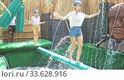 Купить «Friends are looking for adventure in an amusement park», видеоролик № 33628916, снято 23 мая 2020 г. (c) Яков Филимонов / Фотобанк Лори