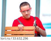 Купить «The young furniture carpenter in industrial concept», фото № 33632296, снято 5 июня 2020 г. (c) easy Fotostock / Фотобанк Лори