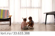 Купить «Children play at home», видеоролик № 33633388, снято 24 апреля 2020 г. (c) Ekaterina Demidova / Фотобанк Лори