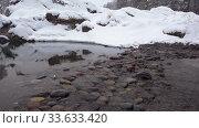 Купить «Stones on a river under heavy snow in winter season. Altai, Blue Lakes, Siberia, Russia», видеоролик № 33633420, снято 7 марта 2020 г. (c) Serg Zastavkin / Фотобанк Лори
