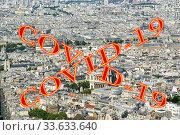 Купить «Coronavirus in Paris, France. Covid-19 sign. Concept of COVID pandemic and travel in Europe. The city skyline at daytime.», фото № 33633640, снято 10 апреля 2020 г. (c) Владимир Журавлев / Фотобанк Лори