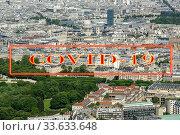 Купить «Coronavirus in Paris, France. Covid-19 sign. Concept of COVID pandemic and travel in Europe. The city skyline at daytime.», фото № 33633648, снято 10 апреля 2020 г. (c) Владимир Журавлев / Фотобанк Лори
