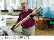 Positive craftsman working on a thicknessing machine. Стоковое фото, фотограф Яков Филимонов / Фотобанк Лори