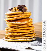 Купить «Pancakes served chocolate, walnut and powdered sugar at plate», фото № 33636256, снято 25 мая 2020 г. (c) Яков Филимонов / Фотобанк Лори