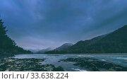 Купить «Time lapse shot of a river near mountain forest. Huge rocks and fast clouds movenings.», видеоролик № 33638224, снято 12 апреля 2018 г. (c) Александр Маркин / Фотобанк Лори
