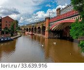 Купить «Manchester, United Kingdom - July 30, 2019: Beautuful view of rennovated Castlefield district in Manchester, UK.», фото № 33639916, снято 30 июля 2019 г. (c) age Fotostock / Фотобанк Лори