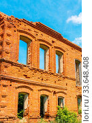 Купить «A big ruined ancient house of red brick against a blue sky with white clouds.», фото № 33648408, снято 26 мая 2020 г. (c) easy Fotostock / Фотобанк Лори