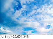 Купить «Blue sky background. Picturesque colorful clouds lit by sunlight. Vast sky landscape panoramic view», фото № 33654348, снято 8 июля 2019 г. (c) Зезелина Марина / Фотобанк Лори